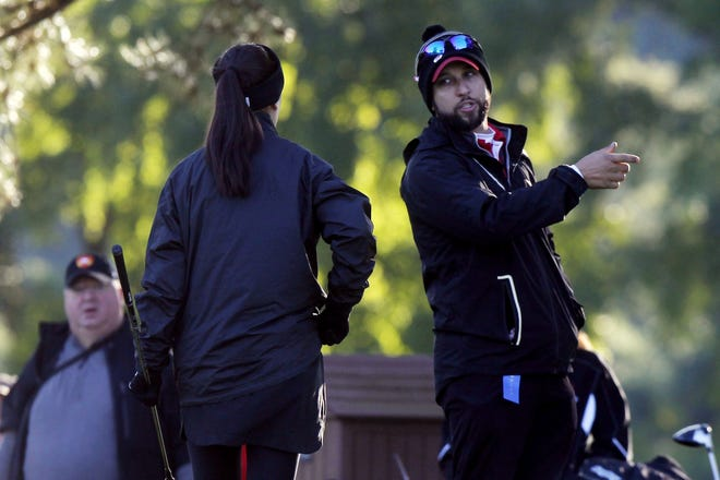 Columbus School for Girls golfer Caroline Kromalic talks to coach Chris Ditello during the Division II state tournament last season. The Unicorns earned a return trip to state by winning a district title Oct. 5 at Darby Creek.
