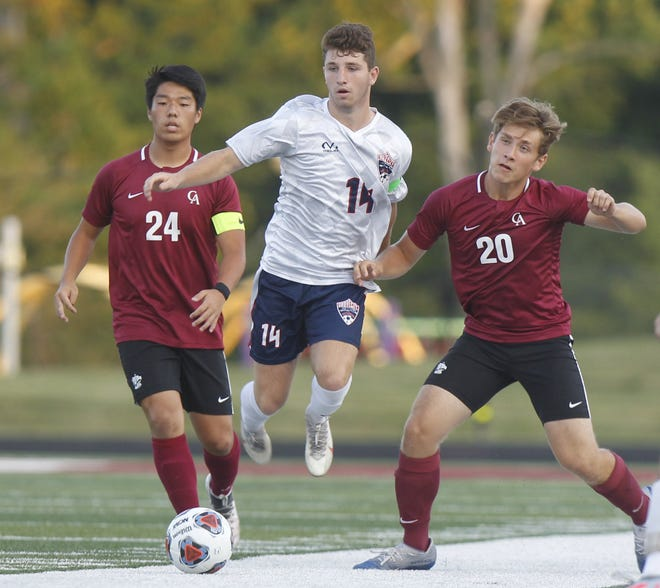 Nick Isaac, center, is winding down his career with the Grove City boys soccer team. An Ohio State commit, Isaac had 43 goals and 16 assists for his career before the Greyhounds played Westland on Oct. 13.
