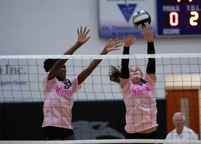 Central's Chloe Jackson (left) and Rylee Osborne go for a block against host North during a match Sept. 29. The Tigers are contending for the OCC-Buckeye Division championship despite a young roster.