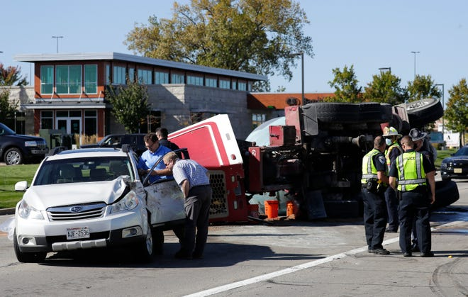 Officials investigate the scene of a crash that involved a cement truck and multiple vehicles along West Wisconsin Avenue near Interstate 41 on Wednesday, October 7, 2020, in Grand Chute, Wis.