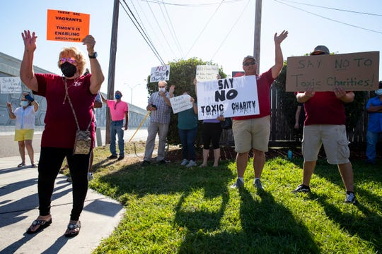 People gather to protest Timon's Ministries' groundbreaking for their building addition and renovation on Wednesday, Oct. 7, 2020.