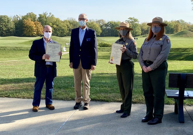 Paul LaRue, a former history teacher from Washington Court House, and Hopewell Culture National Historical Park rangers accept a preservation award from the Ohio History Connection for a collaborative effort to create a new lesson plan for students.