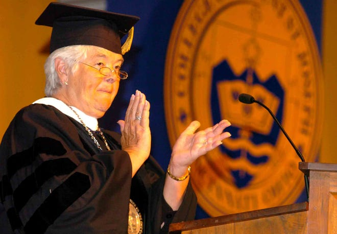 Sister Francis Marie Thrailkill, member of the Order of St. Ursula and president of Mount St. Joseph, applauds the students as she spoke during the College of Mount St. Joseph Commencement Exercises, now Mount St. Joseph University, for the class of 2008 in Delhi.