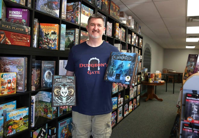 Dungeon's Gate owner Rob McAllister poses for a photo in his game and book store on Wednesday, Oct. 7, 2020, in Ankeny.
