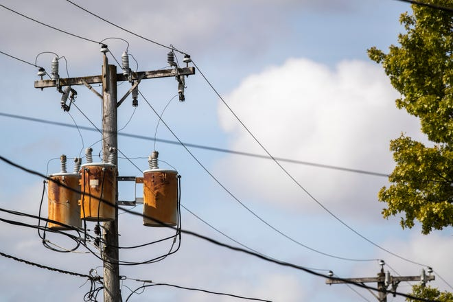 Electric lines are seen stretching from utility poles, Friday, Oct. 2, 2020, in Kalona, Iowa.