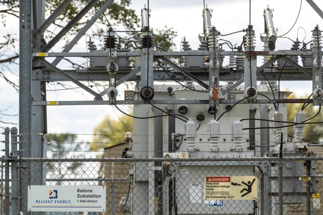Barbed wire covers the top of a chain link fence surrounding an Alliant Energy electric substation, Friday, Oct. 2, 2020, in Kalona, Iowa.