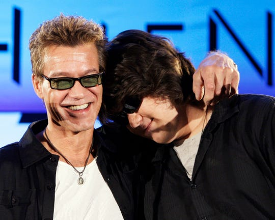 Eddie Van Halen, left, hugs his son Wolfgang Van Halen after rock group Van Halen officially announced their North American tour during a press conference in Los Angeles on August 13, 2007. Eddie Van Halen, who fought against the cancer, died on Tuesday, 6 October 2020. He was 65 years old.