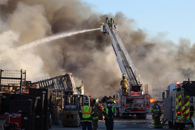 A massive pallet fire at Keegan Enterprises on Ohio 101  generated smoke clouds that could be seen from miles away Wednesday night in Sandusky and Erie Counties. The fire started around 4 p.m., according to Sandusky County Sheriff Chris Hilton.