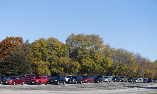 Hundreds of cars line up during Feeding America's food distribution on Wednesday, Oct. 7, 2020, at Northeast Wisconsin Technical College in Green Bay, Wis. The nonprofit organization has been feeding 500-700 households each time they have food drop-offs in Green Bay.