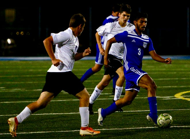 Chillicothe's Michael Lapurga dribbles past two defenders in the Cavaliers' 4-1 win over McClain on Tuesday.