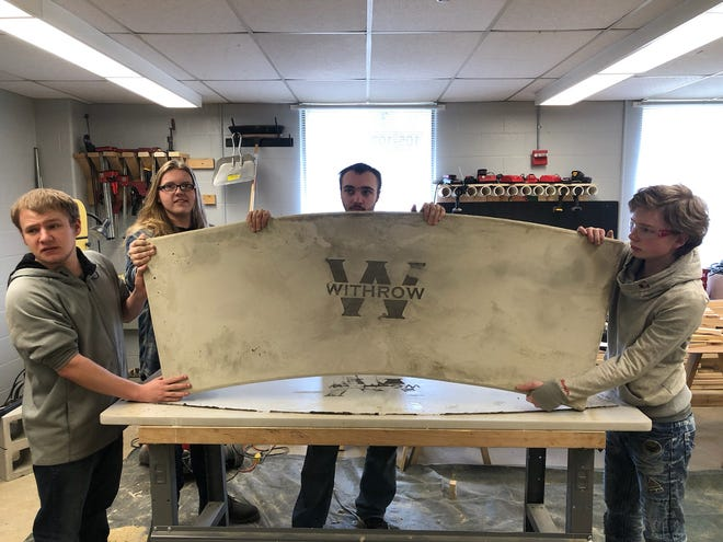 From left to right: Tyler Cave, Levi Bale, Dennis Stamp-Golberg and Jacob Brown showcased a special type of printing and overlaying on a stone slab in the construction technology course last school year.
