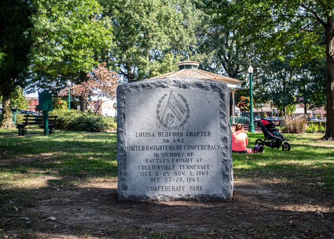 """A stone marker from the Louisa Bedford Chapter of the United Daughters of the Confederacy sits in Collierville's Town Square Park on Wednesday, Oct. 7, 2020. The marker is dedicated to the memory of battles fought in Collierville in 1863. Toward the bottom of the stone an inscription reads """"Confederate Park."""""""