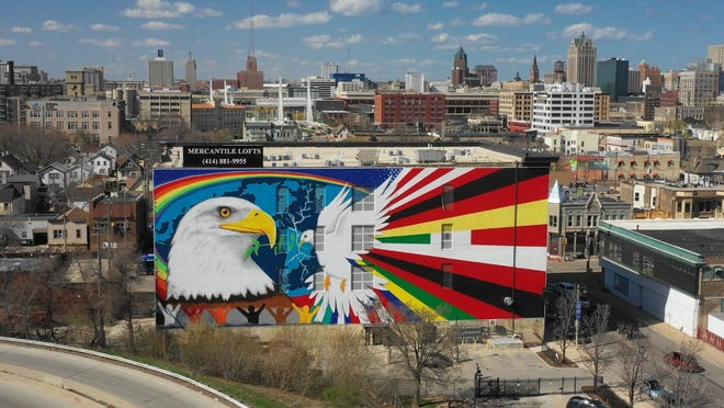 """""""Mural of Peace"""" by muralist Reynaldo Hernandez has become an iconic landmark on Milwaukee's south side. Its creation is featured in the new documentary """"Latino Wisconsin,"""" airing on Milwaukee PBS Oct. 8."""