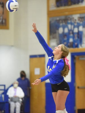 Mountain Home's Katelyn Hill serves during the Lady Bombers' victory over Vilonia on Tuesday night.