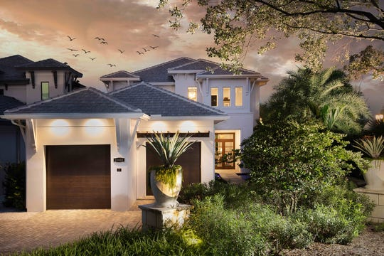 Seagate's Sonoma model features an outdoor living area with conversation and dining areas, a fireplace, outdoor kitchen, pool bath, and a custom pool and spa.