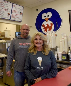 Dustin and Wendi Calhoun, owners of Whit's Frozen Custard in Johnstown, enjoy running the business that allows them to balance family, work, and Dustin's passion for coaching football.
