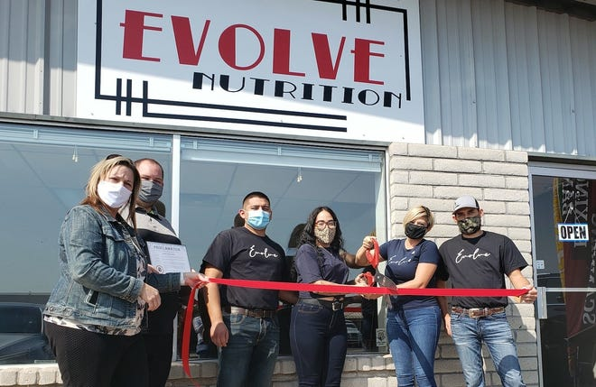 Evolve Nutrition officially joined the Deming business circle with a ribbon-cutting ceremony on Monday at 1212 Columbus Road. Evolve Nutritionwas started by Jeca Jara and Iris Wilmes. Their goal is to provide healthy nutrition to the community through individual coaching and meal plans to fit every client.Various workouts are available throughout the week. Formore information stop by 1212 Columbus Road or call 575-694-0231. Evolve Nutrition isopen from 6 a.m. to 6 p.m. Monday through Friday and from 8 a.m. to 3 p.m. on Saturday. Pictured from left are: Vicki Chavez, chamber board president;John Richmond, chamber executive director;Manuel Mendez, Jeca Jara, Iris Wilmes, and Cody Wilmes.