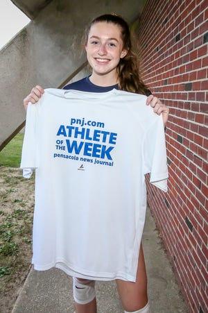 Gulf Breeze junior Lauren Kellen receives her PNJ Athlete of the Week shirt on Tuesday, October 6, 2020.