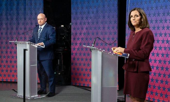 Democratic challenger Mark Kelly and Republican Sen. Martha McSally debate at the Walter Cronkite School of Journalism at Arizona State University on Oct. 6, 2020.
