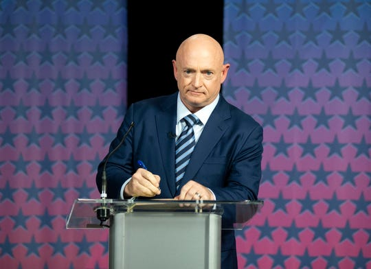 Democratic challenger Mark Kelly prepares to debate Republican Sen. Martha McSally at the Walter Cronkite School of Journalism at Arizona State University on Oct. 6, 2020.