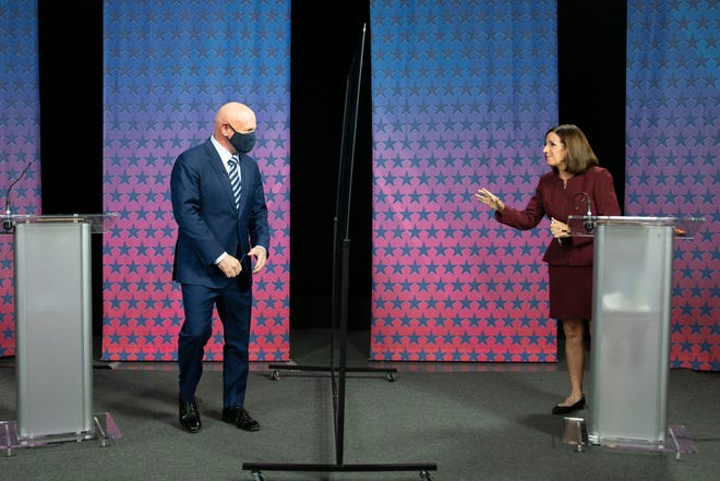 Democratic challenger Mark Kelly arrives to debate U.S. Sen. Martha McSally, R-Ariz., at the Walter Cronkite School of Journalism in Phoenix on Oct. 6, 2020.