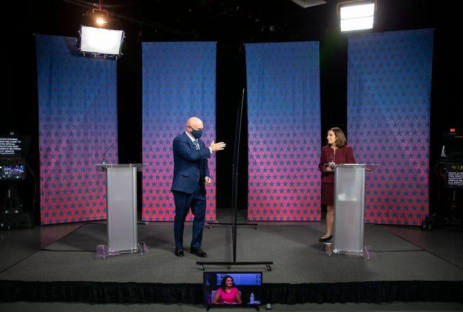 Democratic challenger Mark Kelly arrives to debate Republican Sen. Martha McSally at the Walter Cronkite School of Journalism at Arizona State University on Oct. 6, 2020.