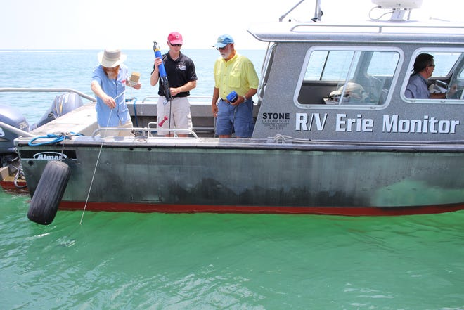 Researchers from the Ohio State University's Stone Laboratory take measurements related to harmful algal blooms in Lake Erie.
