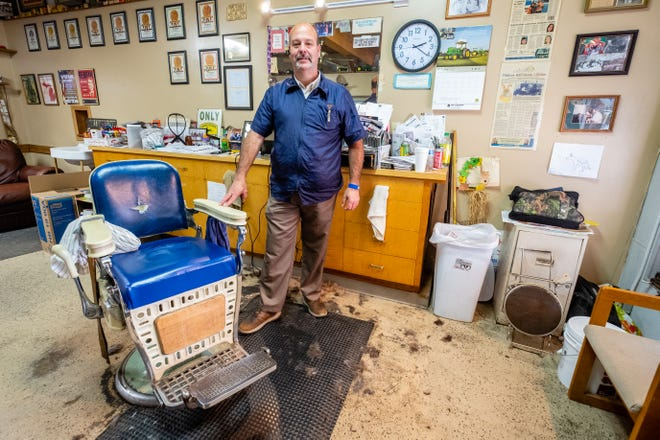 Mark Heberling, shown Tuesday, Oct. 6, 2020 in his Sandusky barbershop, isn't afraid to let his conservative stance be known to customers.