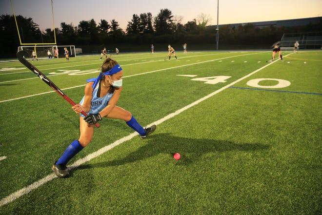 John Jay High School field hockey player Rachel Tama runs a drill during practice on October 6, 2020.