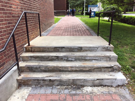 Dilapidated steps are pictured at Clinton Elementary School.