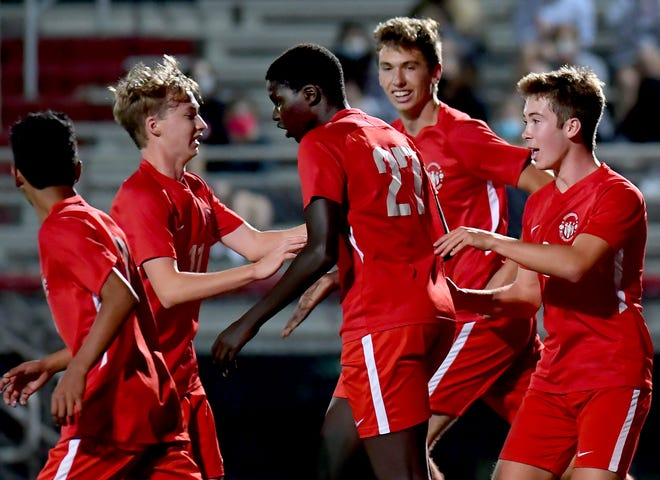 Susquehannock players celebrate with Abass Ndiaye, center, who scored the first goal against West York during soccer at Susquehannock High School Tuesday, Oct. 6, 2020. Bill Kalina photo