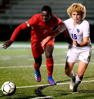 Susquehannock's Fallou Cisse, left, and West York's Gavin Smyser chase a loose ball during soccer action at Susquehannock High School earlier this season. The Warriors (12-0-0) have earned the No. 1 seed in District 3 Class 3-A.