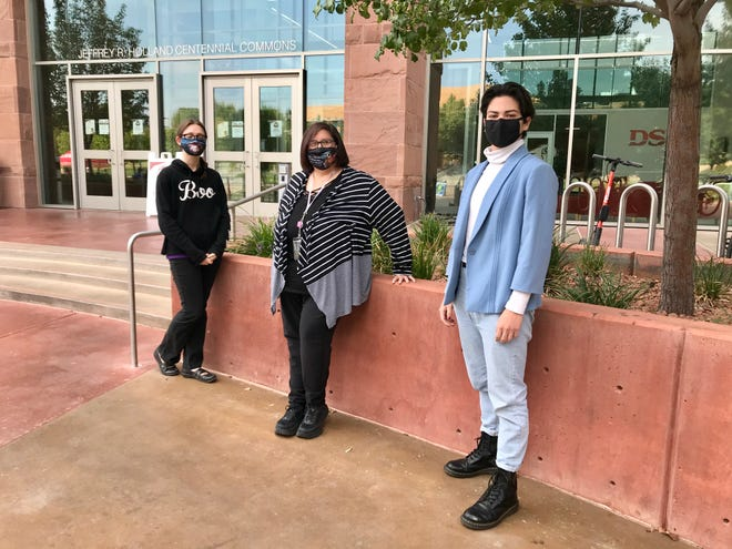 Three members of the student editorial staff for The Southern Quill stand outside the Dixie State University library where they often meet to work. From left: Morelia Lee, Mary McFadden and Yasel Avalos.