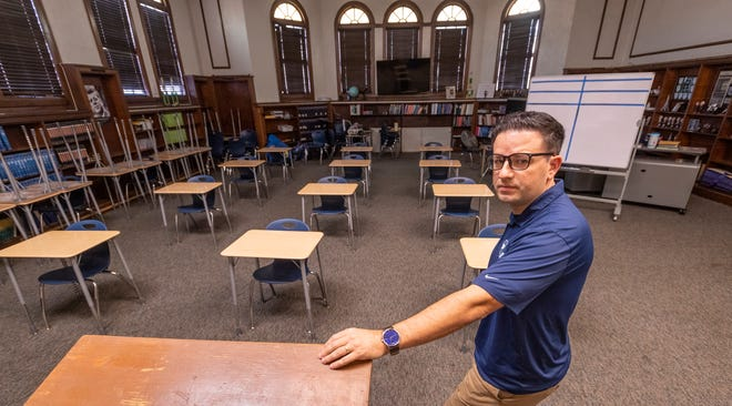 Redwood High School teacher Jason Vieira in his classroom on Wednesday, October 7, 2020. For now, due to COVID-19, he connects with his U.S. History students via Zoom at a station in the back corner of his classroom. Vieira also coaches girls soccer.