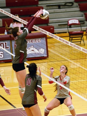 Abigail Walker, of John Glenn, blocks the ball against Sheridan in a match earlier this season. Walker was named the MVL Big School Division player of the year.