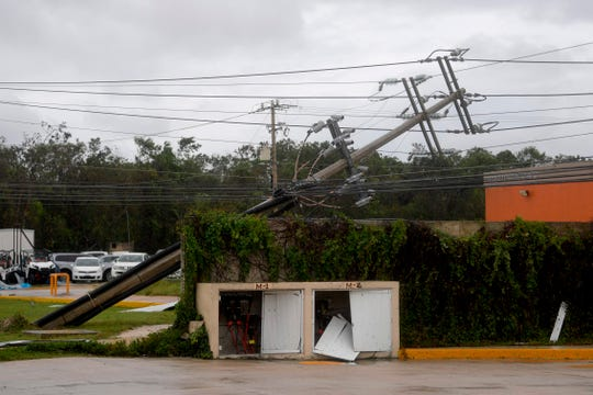 Hurricane Delta knocked over power lines and trees in Cancun, Mexico, after making landfall on Wednesday along the Yucatan Peninsula.