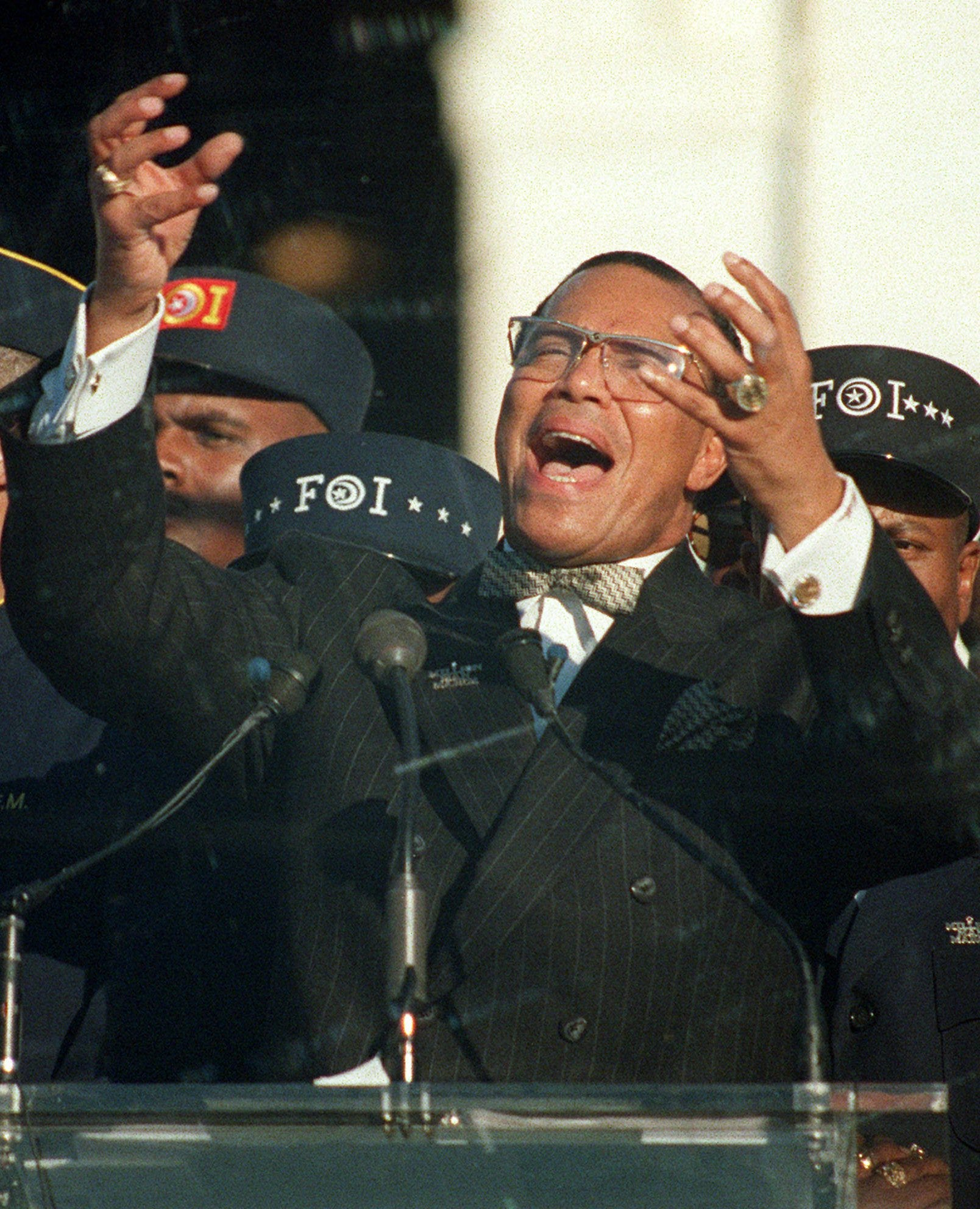 In this Monday, Oct. 16, 1995 file photo, Nation of Islam leader Louis Farrakhan addresses the Million Man March from Capitol Hill in Washington.