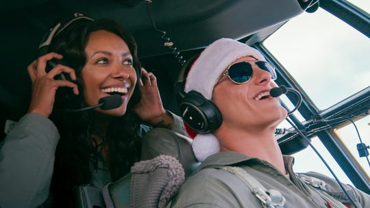 "Erica (Kat Graham) and Andrew (Alexander Ludwig) are all smiles in ""Operation Christmas Drop."""