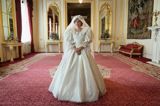 "Emma Corrin wears a replica of Princess Diana's iconic wedding dress on Season 4 of ""The Crown."""