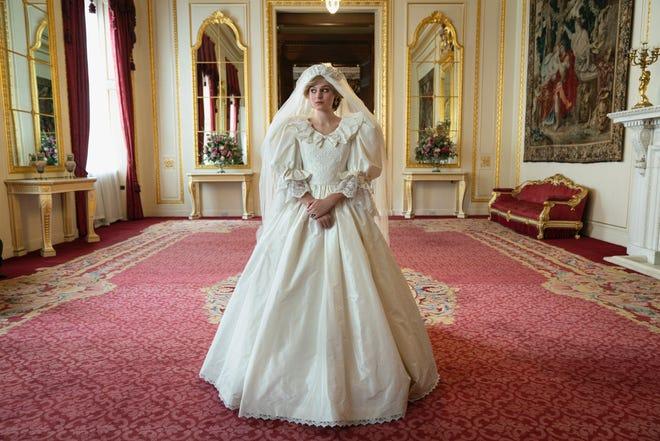 "Emma Corrin wears a replica of Princess Diana's iconic wedding dress on Season 4 of ""The Crown."""