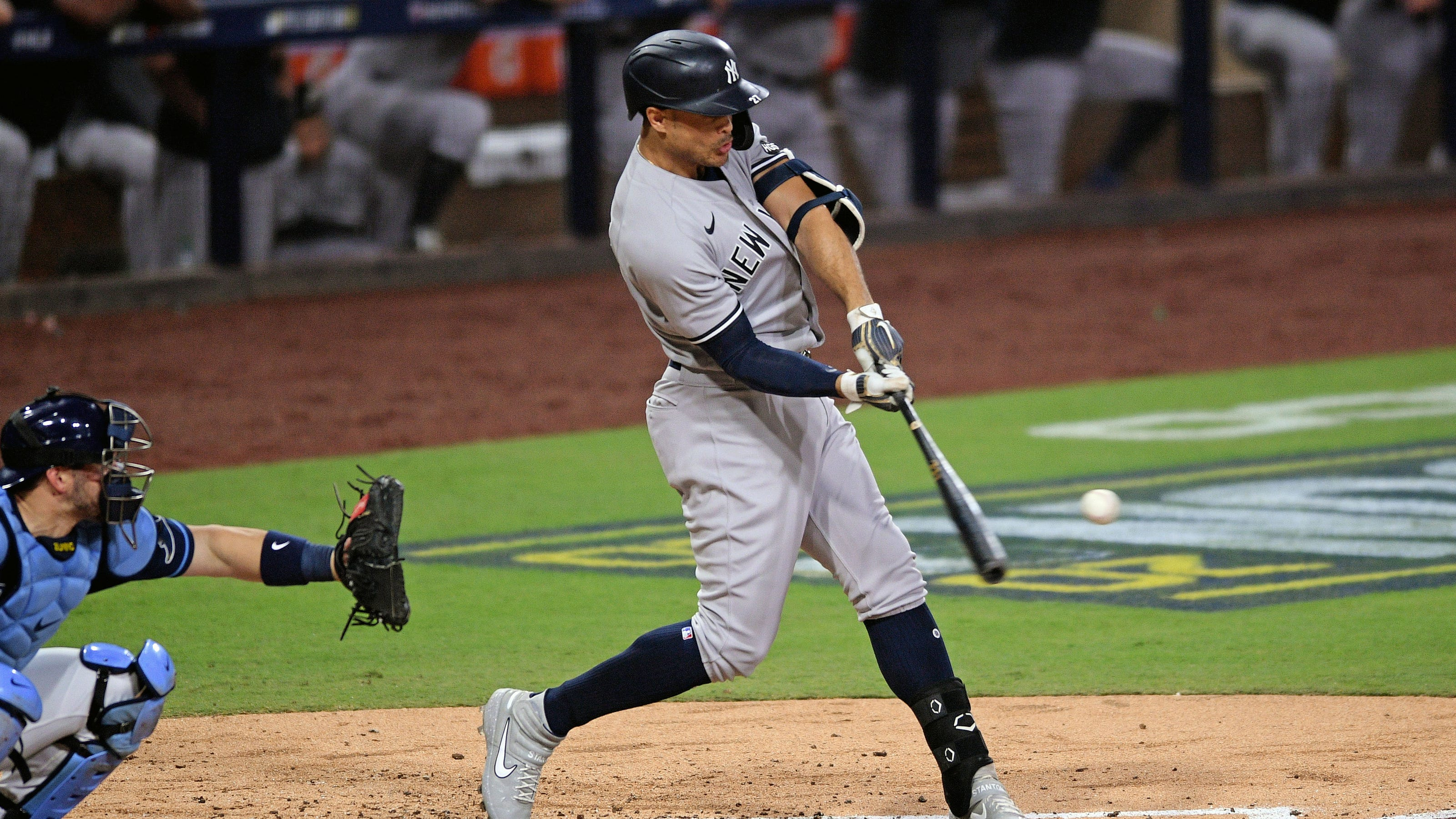 Yankees 2021 Season Preview - Giancarlo Stanton hitting a baseball in the 2020 ALDS
