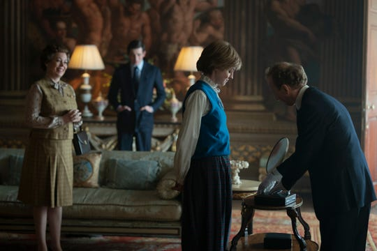 "Queen Elizabeth II (Olivia Coleman) and Prince Charles (Josh O'Connor) as Princess Diana (Emma Corrin) picks her famous engagement ring in Netflix's ""The Crown."""