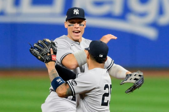 Aaron Judge and Gleyber Torres celebrate a Yankees win in the wild-card series against Cleveland.