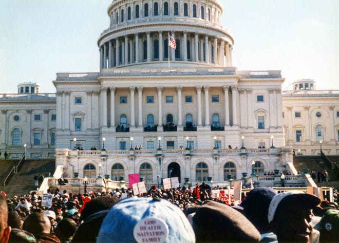 The crowd at the Million Man March faces the US Capitol building.