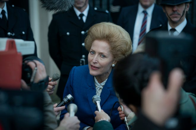 """Gillian Anderson makes her """"The Crown"""" debut as Prime Minister Margaret Thatcher, complete with big wig and old-age makeup."""