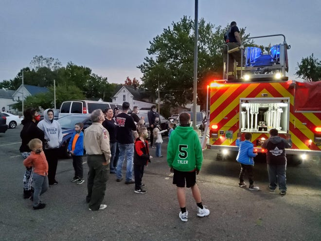 Lexington Township Volunteer Fire Department brought out several emergency vehicles for a local Cub Scout troop to inspect as part of the children's efforts to complete a patriotism challenge.