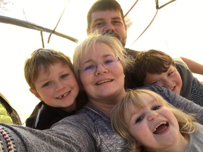 A photo of Tasha Preston and her family.