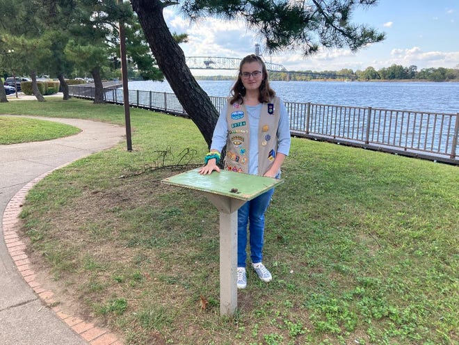 Girl Scout Ella Anzuini, 15, stands at the platform on which her Little Free Library was affixed on the waterfront in Burlington City, N.J. She built the library for her scout Silver Award project in 2019, only to have it stolen a year later.