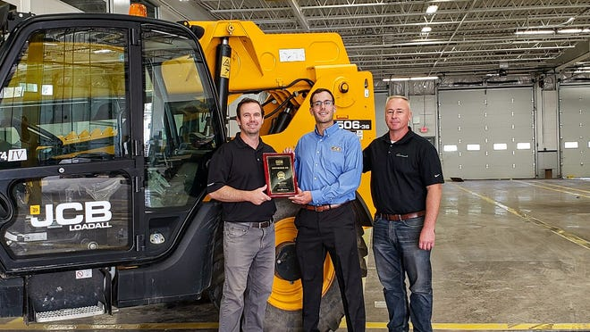 From left: Dillon Hagy, JCB North America's Northeast Regional business manager; Doug Taylor, president and CEO of Earthborne Inc.; and Joe Robinson, Earthborne sales manager, at the new dealership in Warrington.