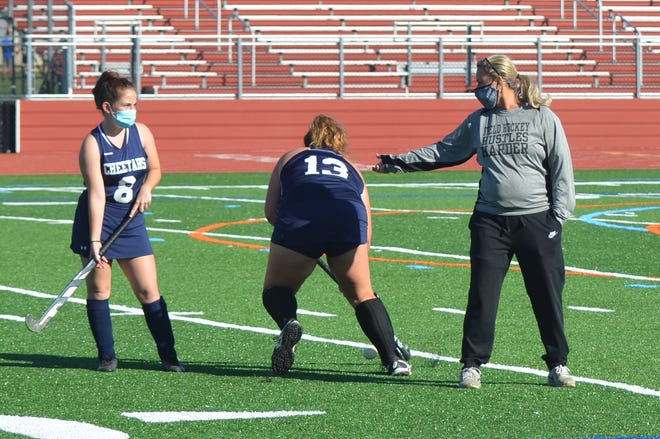 From left, Sydney Volpe and Jenny Depka do a stick handling drill for Gloucester County Tech coach Karen Devito